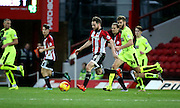 Brentford midfielder Alan Judge setting up another attack during the Sky Bet Championship match between Brentford and Huddersfield Town at Griffin Park, London, England on 19 December 2015. Photo by Matthew Redman.