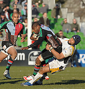 Twickenham, GREAT BRITAIN, Warriors, Sam TUITUPOU,  tackles, Ugo MONYE, during the Guinness Premiership match, Harlequins vs Worcester Warriors, played at the Twickenham Stoop on Sat. 16th Feb 2008  [Mandatory Credit, Peter Spurrier/Intersport-images]
