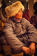 Man at party, festival of one thousand camels, Bulgan, Gobi desert in winter, Mongolia