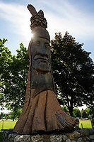 Repairs are being considered for the carved Indian statue that watches over Opechee Park.  (Karen Bobotas/for the Laconia Daily Sun)