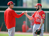 Angels' pitcher Matt Shoemaker knuckles pitching coach Charles Nagy after throwing to live batters during workouts at the Angels' Spring Training facility in Tempe, AZ on Wednesday, February 22, 2017. (Photo by Kevin Sullivan, Orange County Register/SCNG)