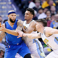 06 March 2016: Dallas Mavericks guard Deron Williams (8) looks to pass the ball over Denver Nuggets guard Axel Toupane (6) and Denver Nuggets guard Mike Miller (3) during the Denver Nuggets 116-114 overtime victory over the Dallas Mavericks, at the Pepsi Center, Denver, Colorado, USA.