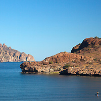 Mexico, Baja California Sur, Loreto. Stand up paddle boarder in Danzante Bay at Villa del Palmar Loreto.