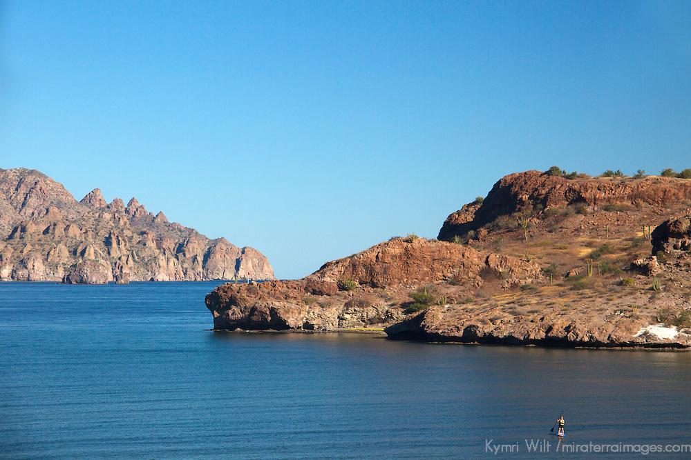 Mexico, Baja California Sur, Loreto. Stand up paddle boarder in Danzante Bay at Villa del Palmar Loreto.