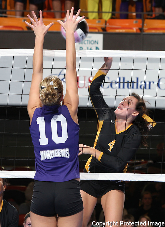 Janesville's Karli Kruse (4) tries to get the ball past Janesville's Talere Sorge (10) during the first game of their 1A semifinal match in the state volleyball tournament at the U.S. Cellular Center at 370 1st Ave E on Friday evening, November 12, 2010. (Stephen Mally/Freelance)
