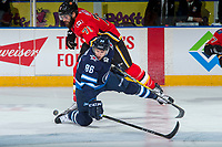 PENTICTON, CANADA - SEPTEMBER 11:  Hunter Smith #71 of Calgary Flames checks Mathieu Sevigny #86 of Winnipeg Jets on September 11, 2017 at the South Okanagan Event Centre in Penticton, British Columbia, Canada.  (Photo by Marissa Baecker/Shoot the Breeze)  *** Local Caption ***