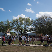 Students and parents arrive for campus orientation at the Marjory Stoneman Douglas high school for reopening following last week's mass shooting in Parkland, Florida, U.S., February 25, 2018. Attendance was voluntary but hundreds of students and parents showed up. The school opens this coming Wednesday. Seventeen persons including students and staff were murdered in the shooting. REUTERS/Angel Valentin