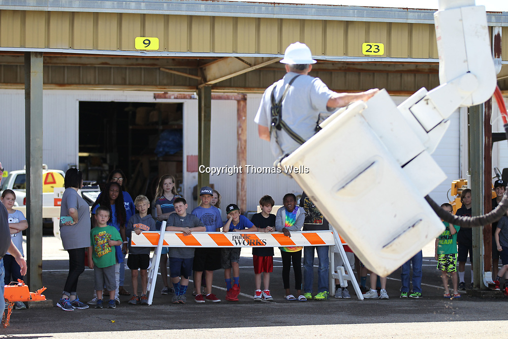 Students from CASA watch closely as Josh Vanstory shows off the felxibility of the bucket trucks at Tupelo Public Works.