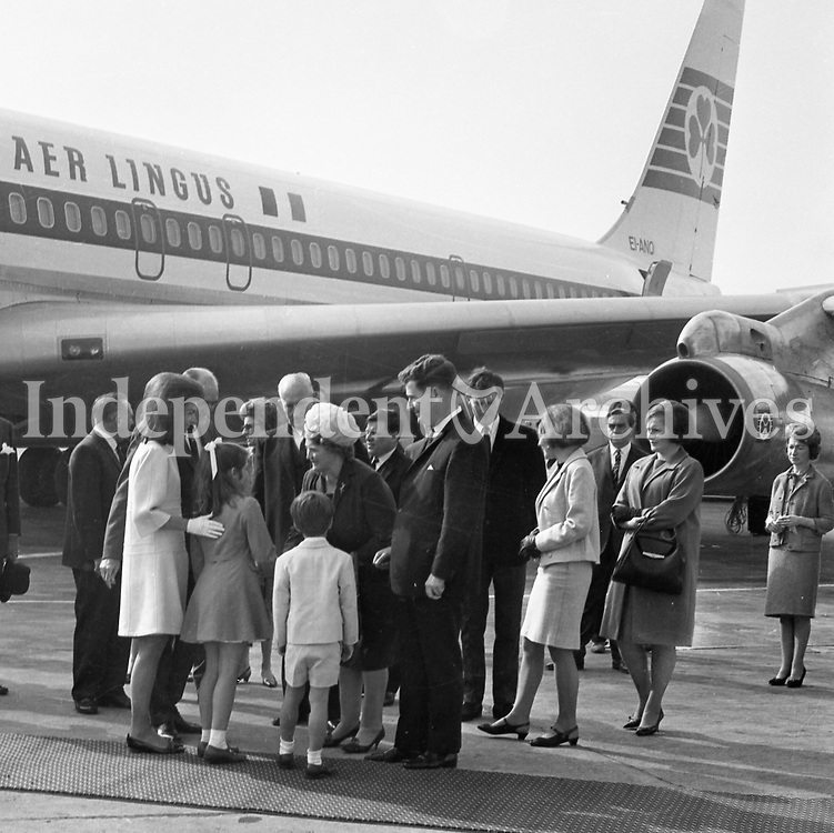 Jacqueline Kennedy's visit to Ireland, June 1967.<br /> (Jacqueline &quot;Jackie&quot; Lee Bouvier Kennedy Onassis)<br /> Jacqueline Kennedy with her children John and Caroline being greeted on their arrival at Shannon Airport, on the runway.<br /> June 30th 1967.<br /> (Part of the Independent Ireland Newspapers/NLI Collection)