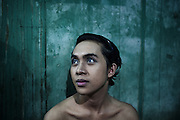 JAKARTA, INDONESIA, MARCH 2013: A young transgender puts make up on in his bedroom at Mami Joyce's house.<br /> Traditionally a target of harassment and intimidation in the world&rsquo;s most-populous Muslim country, transgenders in Indonesia - also called 'waria', a term that combines the Indonesian for woman (wanita) and the word for man (pria) - have lately been fighting for better acceptance, thanks to the work of some trail-blazing activists who have themselves endured decades of hardship. <br /> After seeing many colleagues fall victim to AIDS and other fatal diseases, &ldquo;Mami&rdquo; Joyce now takes care of 20 young transgender sex workers living with her as if in a big family. &ldquo;Mami&rdquo; Yuli, a prominent human rights campaigner, has set up a shelter for elderly transgenders, partly funded by a network of churches and a government that until two years ago still deemed them &ldquo;mentally ill&rdquo;. <br /> Also thanks to their efforts, there are signs that the future is getting brighter for this marginalized community, which activists estimate to be at least 3 million-strong in Indonesia. But much still needs to be done, and the threats by recently-emboldened Islamic radicals show that any step towards more tolerance can meet fierce resistance.