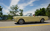 Denis Finnerty of Finn's Garage takes a drive in a 1965 Ford Mustang convertible.  (Karen Bobotas/for the Laconia Daily Sun)