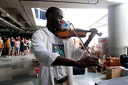31st August, 2005. New Orleans, Louisiana.<br /> Hurricane Katrina aftermath. In a bizarre moment Samuel Thompson plays a last lament for the city at the New Orleans Arena which has become the makeshift hospital for those removed from the Superdome where an estimated 20,000 refugees remain trapped after the storm.. <br /> Photo Credit: Charlie Varley/varleypix.com