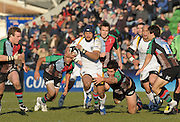 Twickenham, GREAT BRITAIN, Warriors, Sam TUITUPOU, on the run, Nick EASTER low flying tackle, during the Guinness Premiership match, Harlequins vs Worcester Warriors, played at the Twickenham Stoop on Sat. 16th Feb 2008  [Mandatory Credit, Peter Spurrier/Intersport-images]