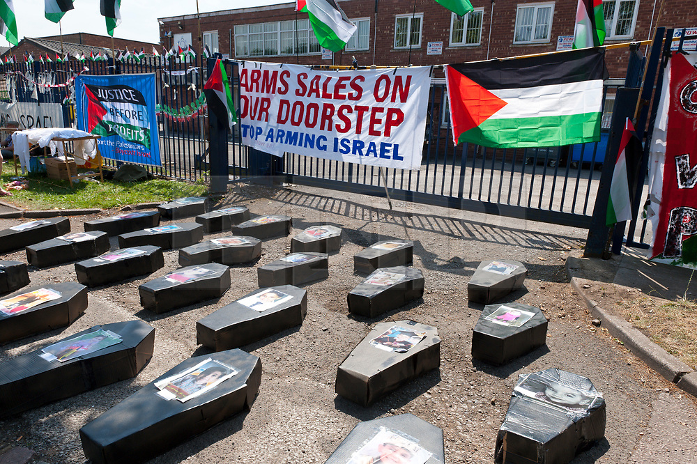 © Licensed to London News Pictures. 06/07/2017. Shenstone, Staffordshire, UK. Cardboard coffins representing Palestinian children murdered by Israeli drones are laid outside the drone factory gate. On the second anniversary of Israel's brutal assault on Gaza in July 2014  in which 2,200 Palestinians were killed, including more than 550 children, campaigners from across the UK travel to Elbit's factory in Shenstone, Lichfield in Staffordshire for a non-violent picket outside the factory gates to demand that the UK stops arming Israel and that Elbit's factory ceases their production of death drones. Elbit's death drones are used by The Israel Defence Force against the people of Palestine. Photo credit: Graham M. Lawrence/LNP