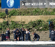 London, Great Britain, Oxford congratulated on the foreshore after winning the first race on the Tideway. The Newton Women's Boat Race, Men's Race , Championship Course.  River Thames. Putney to Mortlake. ENGLAND. <br /> <br /> 17:13:27  Saturday  11/04/2015<br /> <br /> [Mandatory Credit; Peter Spurrier/Intersport-images]<br /> <br /> OUWBC Crew: <br /> Maxie SCHESKE, Anastasia CHITTY, Shelley PEARSON, Lauren KEDAR, Maddy BADCOTT, Emily REYNOLDS, Nadine GRAEDEL IBERG, Caryn DAVIES and Cox Jennifer EHR