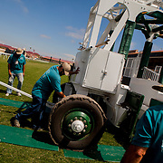 DEL MAR, CA - AUGUST 13, 2014: Members of the grounds crew at the Del Mar Thoroughbred Club set the gates on the turf track. CREDIT: Sam Hodgson for The New York Times