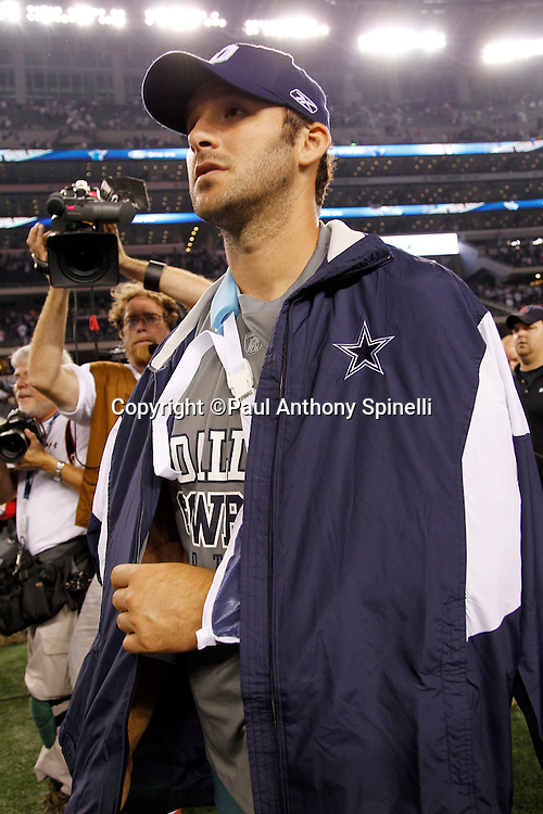 Dallas Cowboys quarterback Tony Romo (9) walks off the field wearing street clothes and an arm sling after incurring a broken clavicle on a hit by a defensive player during the NFL week 7 football game against the New York Giants on Monday, October 25, 2010 in Arlington, Texas. The Giants won the game 41-35. (©Paul Anthony Spinelli)
