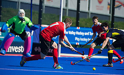 Holcombe's Gareth Andrews scores against Team Bath Buccaneers. Holcombe v Team Bath Buccaneers - Now: Pensions Finals Weekend, Lee Valley Hockey & Tennis Centre, London, UK on 12 April 2015. Photo: Simon Parker