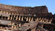 Detail from the Roman Collosseum (also known as the Flavian Amphitheatre), an elliptical amphitheatre in the centre of Rome, Italy. Considered one of the greatest works of Roman architecture and engineering. Built from concrete and stone, with construction starting under the emperor Vespasian in 70 AD, finished in 80 AD under Titus. The amphitheatre also underwent modifications during the reign of Domitian. Named for its association with the Flavius family name of which these 3 emperors belonged. The Collosseum seated 50,000 spectators to view gladiatorial contests and performances. It was later repurposed for many other uses. One of the outstanding physical representations of Imperial Rome.