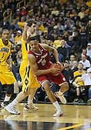 January 19 2013: Wisconsin Badgers forward Ryan Evans (5) drives around Iowa Hawkeyes forward Zach McCabe (15) during the second half of the NCAA basketball game between the Wisconsin Badgers and the Iowa Hawkeyes at Carver-Hawkeye Arena in Iowa City, Iowa on Sautrday January 19 2013. Iowa defeated Wisconsin 70-66.
