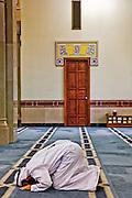 Man praying in a mosque in Jumeirah, Dubai, United Arab Emirates