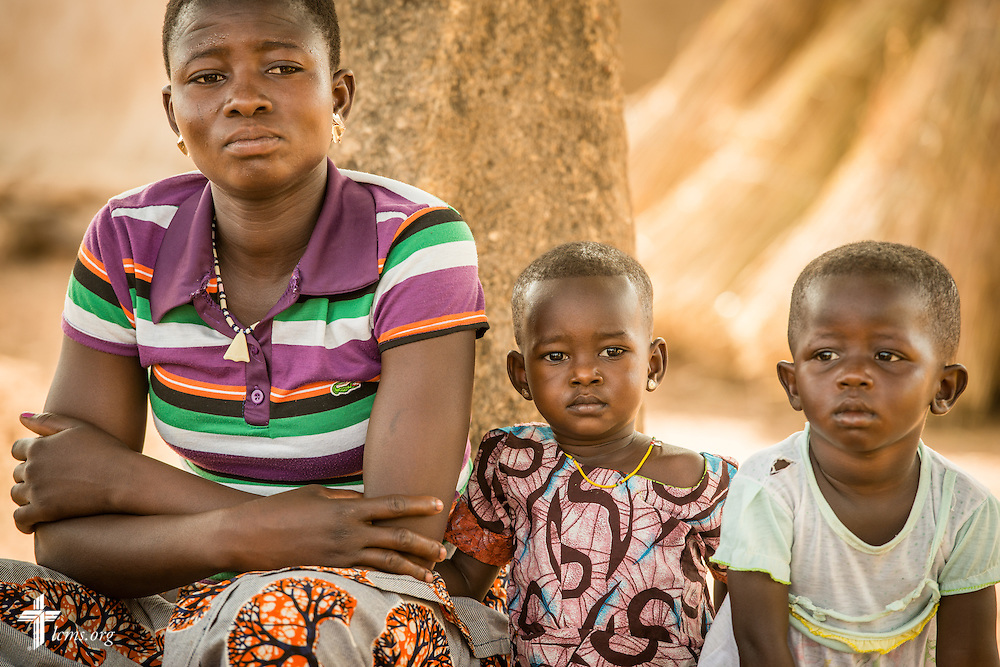Lare Cendrine is joined with her two children as the Rev. Remi Lare Lambon of the Lutheran Church of Togo shares a devotion on Tuesday, Feb. 14, 2017, at a rural home in Sankpong, Togo.  LCMS Communications/Erik M. Lunsford