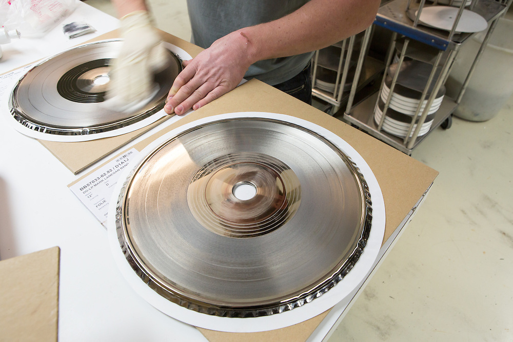 Germany - Deutschland - Optimal Media GmbH - Vinyl Schallplatten Pressung, Fertigung, Produktion; Vinyl Record Pressing - the biggest factory in Germany for record production; HERE: template for pressing;        Roebel, 11.12.14; © Christian Jungeblodt