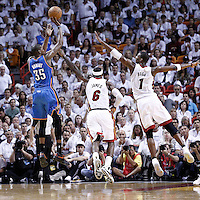19 June 2012: Oklahoma City Thunder small forward Kevin Durant (35) takes a jumpshot over Miami Heat small forward LeBron James (6) and Miami Heat power forward Chris Bosh (1) during the third quarter of Game 4 of the 2012 NBA Finals, Thunder at Heat, at the AmericanAirlinesArena, Miami, Florida, USA.