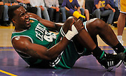 Celtics Kendrick Perkins goes down with a knee injury toward the end of the first half. The Lakers defeated the Boston Celtics in game 6 of the NBA Finals 89-67. Los Angeles, CA 06/15/2010 (John McCoy/Staff Photographer).