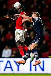 Famara Diedhiou of Bristol City is challenged by Shaun Hutchinson of Millwall - Rogan/JMP - 10/12/2019 - Ashton Gate Stadium - Bristol, England - Bristol City v Milwall FC - Sky Bet Championship.