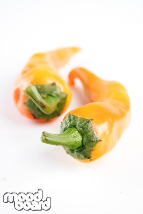 Studio shot of yellow chilli peppers