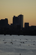 Boston, USA, Boats in the marshaling, and Boston College BC. area fot the start of the first race as the Sun Rises over Boston, on the  second day at the Head of the Charles, Race Charles River,  Cambridge,  Massachusetts. Saturday  21/10/2007 [Mandatory Credit Peter Spurrier/Intersport Images]..... , Rowing Course; Charles River. Boston. USA , Sunrise, Sunsets, Silhouettes