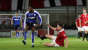 Gboly Ariyibi comes off worse during the The FA Cup match between FC United of Manchester and Chesterfield at Broadhurst Park, Manchester, United Kingdom on 9 November 2015. Photo by Pete Burns.