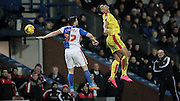 Jonson Clarke-Harris (Rotherham United) heads the ball over Craig Conway (Blackburn Rovers) while Neil Redfearn watches on during the Sky Bet Championship match between Blackburn Rovers and Rotherham United at Ewood Park, Blackburn, England on 11 December 2015. Photo by Mark P Doherty.