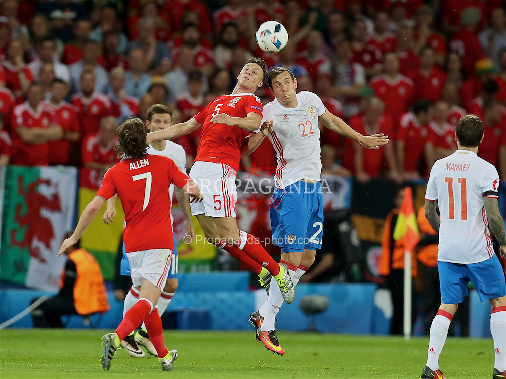 TOULOUSE, FRANCE - Monday, June 20, 2016: Wales' James Chester in action against Russia's Artem Dzyuba during the final Group B UEFA Euro 2016 Championship match at Stadium de Toulouse. (Pic by David Rawcliffe/Propaganda)