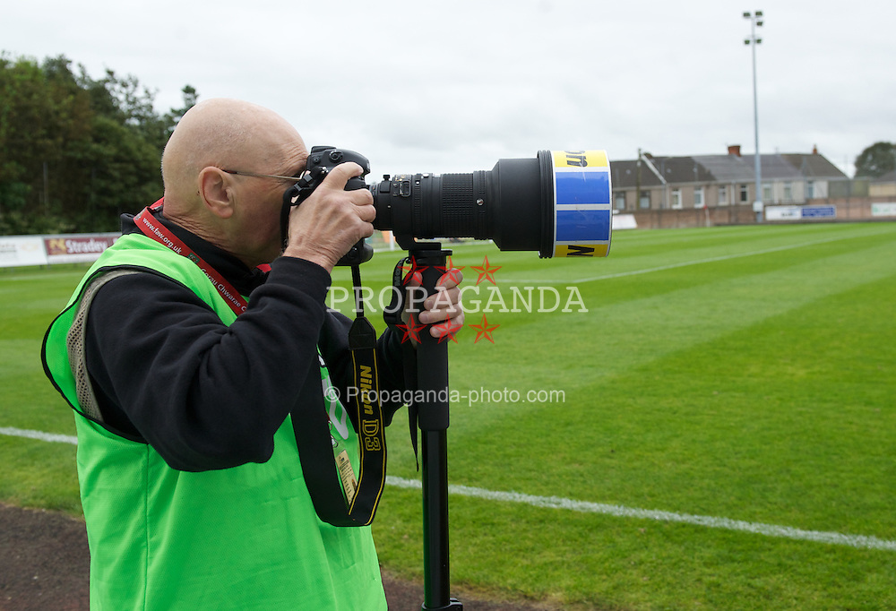 LLANELLI, WALES - Saturday, September 15, 2012: A photographer during the Welsh Premier League match between Llanelli and Newtown at Stebonheath Park. (Pic by David Rawcliffe/Propaganda)