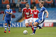 Nottingham Forest midfielder Henri Lansbury (10)  closes down Sheffield Wednesday defender Tom Lees (15)  during the EFL Sky Bet Championship match between Sheffield Wednesday and Nottingham Forest at Hillsborough, Sheffield, England on 24 September 2016. Photo by Simon Davies.