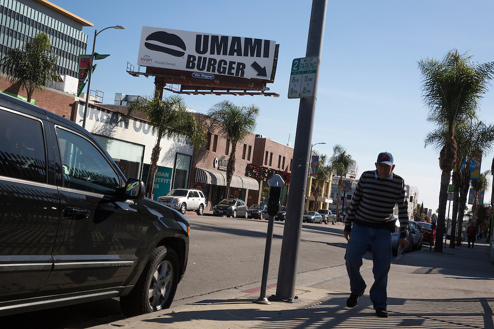 Scenes from Umami Burger at 1520 Cahuenga Blvd in Hollywood, CA. A giant billboard on Cahuenga Blvd in Hollywood points toward the Umami Burger hidden in a courtyard off the street.