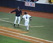 Ole Miss' Austin Anderson is congratulated by first base coach Stephen Head following his game winning three run home run in the 13th inning vs. Auburn at Oxford-University Stadium in Oxford, Miss. on Friday, April 4, 2014. Mississippi won 8-5.