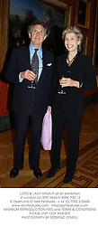 LORD & LADY HINDLIP at an exhibition in London on 30th March 2004.PSZ 14