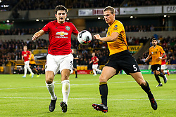 Ryan Bennett of Wolverhampton Wanderers takes on Harry Maguire of Manchester United - Mandatory by-line: Robbie Stephenson/JMP - 19/08/2019 - FOOTBALL - Molineux - Wolverhampton, England - Wolverhampton Wanderers v Manchester United - Premier League