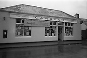 15/02/1963<br /> 02/15/1963<br /> 15 February 1963<br /> Opening of new 5 Star Supermarket at St Agnes Road in Crumlin, Dublin. Picture shows: Candon's off licence and post office at St Agnes Road, with a sign welcoming the new supermarket.