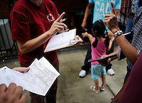 NEW ORLEANS, LA- June 22:  Those in need are told that only 20 individuals will receive assistance per day... Vietnamese affected by the Gulf oil spill because of their work in the fishing industry, wait on an early morning line at Mary Queen of Vietnam Catholic Church to receive financial assistance from Catholic Community Services, in New Orleans, Louisiana, Tuesday June 22, 2010.  (Melina Mara/The Washington Post)
