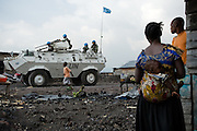 Residents watch as a MONUC armored vehicle drives by in the Majengo neighborhood in Goma, Eastern Democratic Republic of Congo on Monday December 15, 2008.