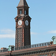 The clock tower on the Erie-Lackawanna Railroad and Ferry Terminal in Hoboken, NJ. Originally built in 1907 by the Delaware, Lackawanna and Western Railroad the building on the Hoboken waterfront allowed rail commuters to transfer to ferries to access New York City on the other side of the Hudson River. The building is registered on both the US National and New Jersey Register of Historic Places. Hoboken, New Jersey, USA