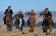 Eagle hunters prepare to demonstrate their eagle for spectators at the annual Eagle Hunting Festival which celebrates Kazakh culture, Bayan Olgi, Mongolia.  Kazakhs have hunted with eagles for centuries.  The Eagle Hunting Festival has revived Kazakh culture which was surpressed under Soviet rule.