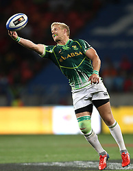 South African captain Kyle Brown stretches to get to the ball during the Cup Final match between South Africa and New Zealand on Day 2 of the HSBC Sevens World Series Port Elizabeth Leg held at the Nelson Mandela Bay Stadium on 8th December 2013 in Port Elizabeth, South Africa. Photo by Shaun Roy/Sportzpics