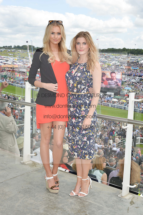Left to right, IANTHE ROSE COCHRANE-STACK and ASHLEY JAMES at the Investec Derby 2015 at Epsom Racecourse, Epsom, Surrey on 6th June 2015.