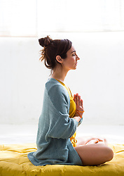Side view of Woman Practicing Yoga, Lotus pose