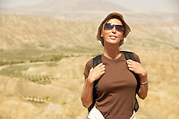 Female hiker standing on top of mountain portrait